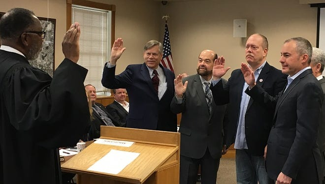 Judge Kurtis Wilder, left, administers the oath to the Conference of Western Wayne's officers for 2017, who were named on Jan. 13. Taking the oath are Northville Township Supervisor Bob Nix II, Dearborn Mayor Jack O'Reilly and Romulus Mayor LeRoy Burcroff. At right is Westland Mayor Bill Wild, the chairman emeritus.