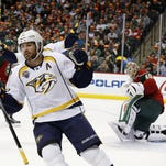 Nashville Predators center Mike Fisher (12) reacts after scoring on Minnesota Wild goalie Devan Dubnyk, right, during the second period Thursday in St. Paul.