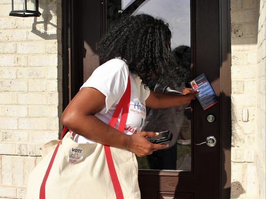Rhonda Oats canvasses the Ryan Ridge neighborhood on Tuesday, June 19. Oats will face DeVona Sims in a runoff election for the District 5 Board of Education Democratic nomination.