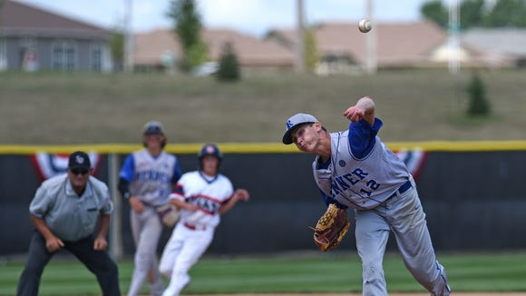 Runner's #12 Spencer Koelewyn pitches against Sioux