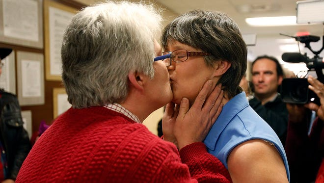Angela Channell, right, and Dawn Hicks, left, celebrate with a kiss after receiving their marriage license on Friday, Feb. 13, 2015. Channell and Hicks were the first couple to apply for and receive a marriage license from Tuscaloosa county for a same sex marriage. (AP Photo /The Tuscaloosa News, Robert Sutton)