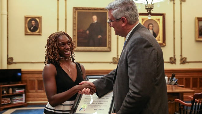 Pike High School track star Lynna Irby is awarded the Sagamore of Wabash from Indiana Gov. Eric Holcomb, the first time Indiana's highest honor has been awarded to a high school student, at the governor's office in the Indiana Statehouse, Indianapolis, Thursday, July 27, 2017. The Pike graduate will attend University of Georgia this fall on a track scholarship.