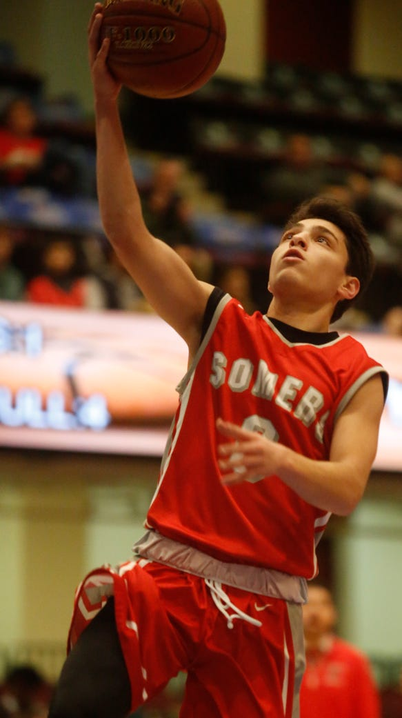 Somers Gio Tradito (0) shoots during the challenge
