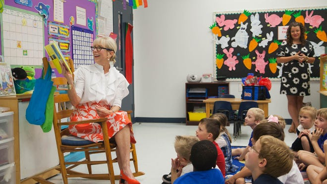 Florida First Lady Ann Scott reads aloud to Holy Comforter School students in 2015 to promote literacy and to encourage kids and families to read together. Scott continued her literacy tour throughout the summer.