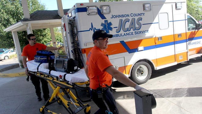 Johnson County Paramedics respond to a call on July 31, 2012
