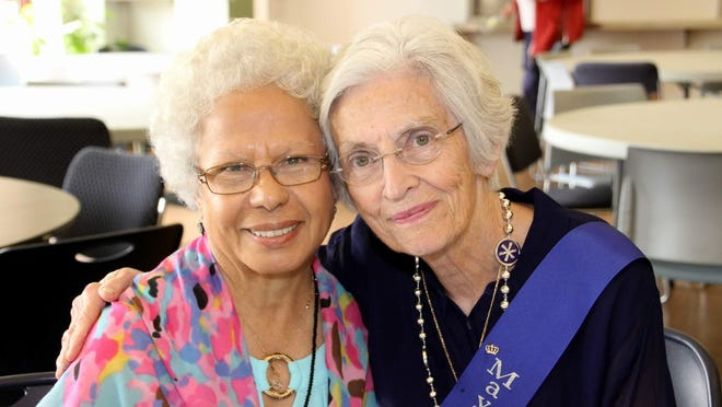 "Long-time Webster Senior Center member Edith Ortiz, left, with Faith Bell. In her remarks at Faith's retirement party, Edith told her, ""The world needs more people like you."""