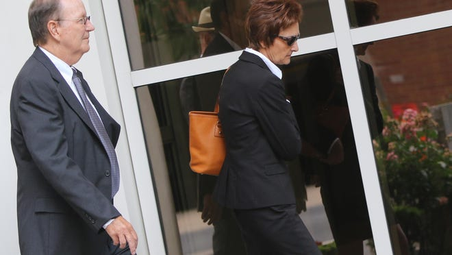 Former Wilmington Trust Controller Kevyn Rakowski (right) exits the J. Caleb Boggs Federal Building with her lawyer in 2015.
