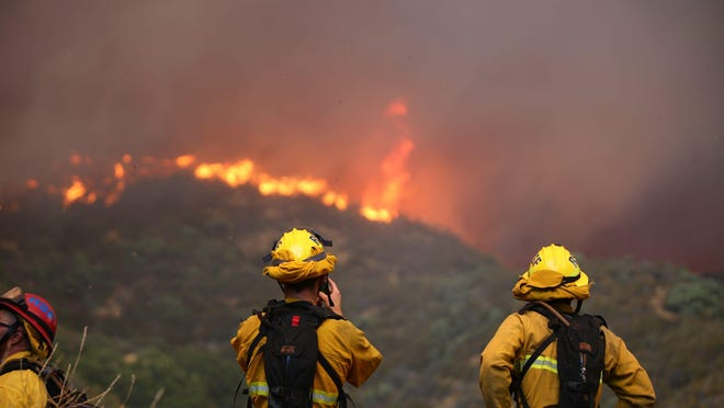 The Apple Fire continues to burn in the Banning bluff area of Riverside County on Saturday, August 1, 2020.