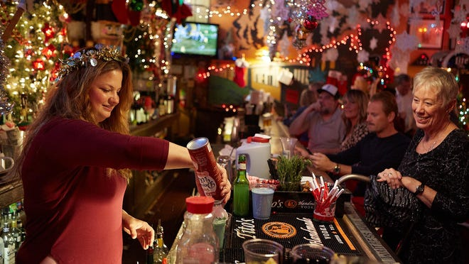 Christmas themed drink specials are available at Donn's Depot, such as The Grinch seen being prepared here on September 25 2019. Dave Creaney / AMERICAN-STATESMAN
