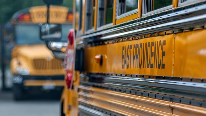 There aren't enough buses to transport everyone to school, because buses can only run at a third of their former capacity. School buses parked at East Providence Ocean State Transit Monday afternoon.