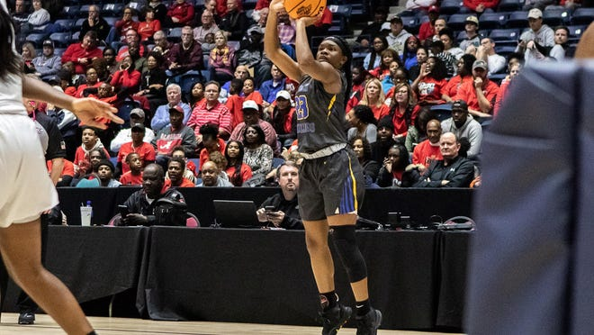 Beach's Kaila Rougier shoots a 3-pointer against Greater Atlanta Christian in the GHSA Class 3A championship game on March 5, 2020 in Macon.