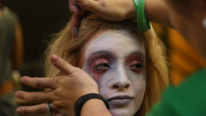 """North High School student Adrianna Secori has her makeup applied for her role in """"The Addams Family"""" on Tuesday."""