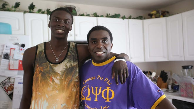 Gene Hawkins (right) has been a Big Brother to Alex Oladimeji (left) for the past four years. Now Oladimeji, 18, has graduated high school and will attend Indiana State University to study music and business. They are seen at Hawkins' Indianapolis residence on Friday, June 20, 2014.