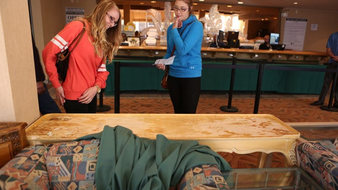 Danielle Taylor, left, and Kelsey Jarrell, both of Twentynine Palms, shop during the liquidation sale at the Spa Resort Hotel in Palm Springs on Friday, November 29, 2014.