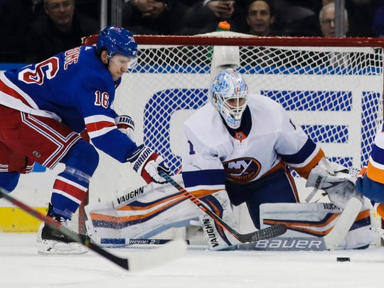 New York Islanders goaltender Thomas Greiss (1) defends his net from New York Rangers' Ryan Strome (16) during the first period of an NHL hockey game Tuesday, Jan. 21, 2020, in New York. (AP Photo/Frank Franklin II)