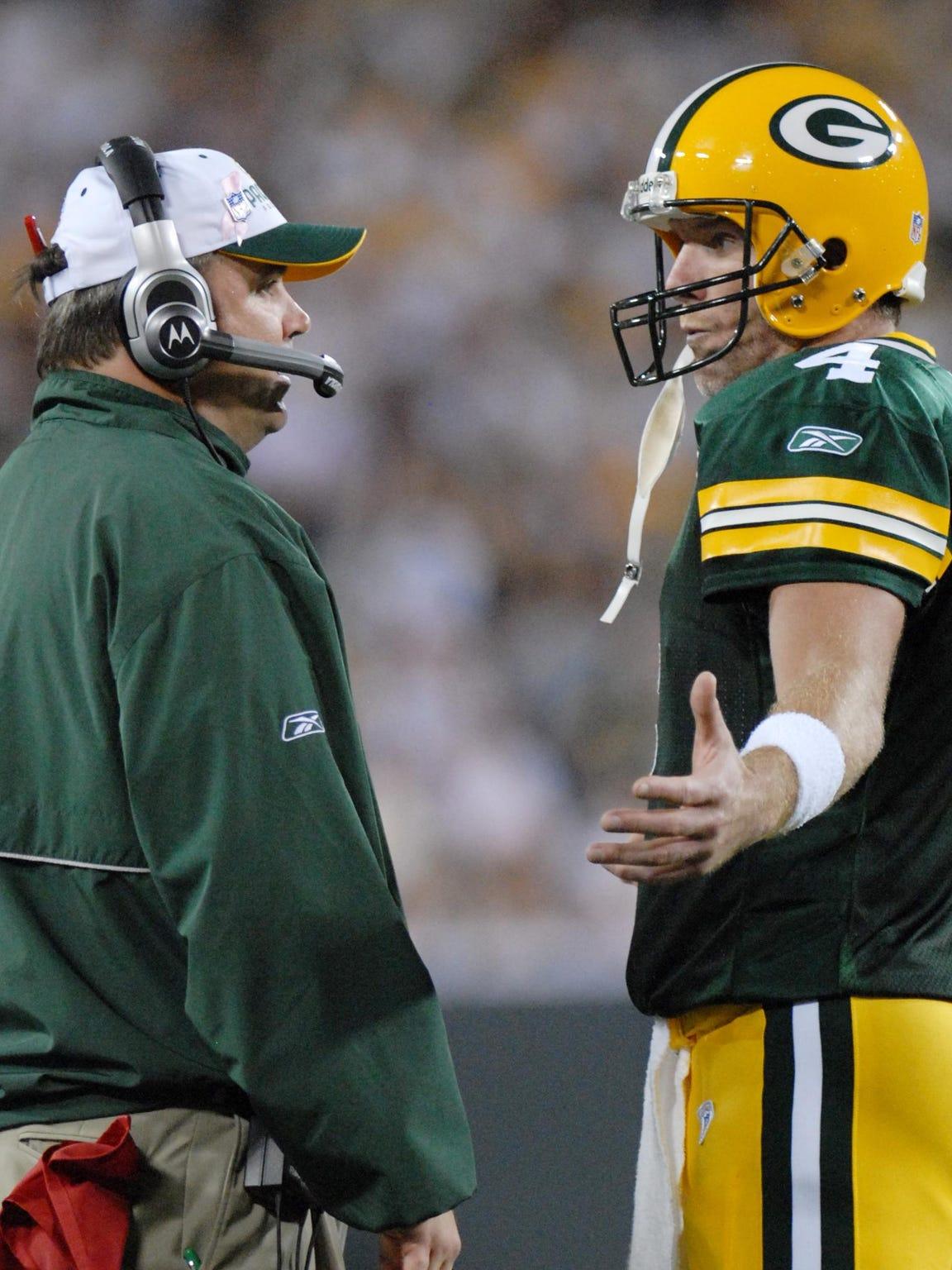 Green Bay Packers head coach Mike McCarthy, left, talks