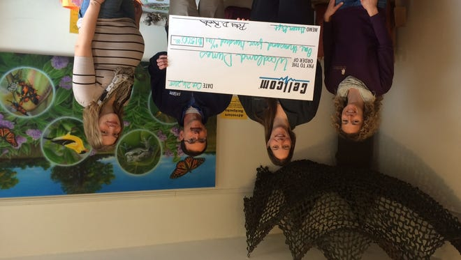 Woodland Dunes Nature Center received a $,1500 Green Gift from Cellcom this week at a presentation at its facility. Pictured, from left, are Woodland Dunes education coordinator Jessica Johnsrud, Cellcom's Kristy Stark and Jaimie Salta and Woodland Dunes marketing and development coordinator Corrissa Frank.