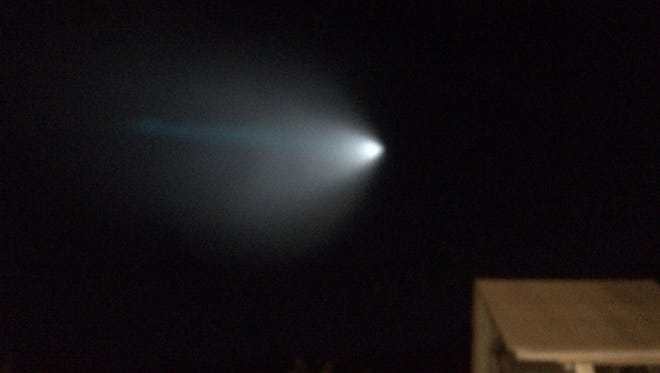 A light from a Navy unarmed missile is seen over Thousand Oaks, Calif., on Saturday.