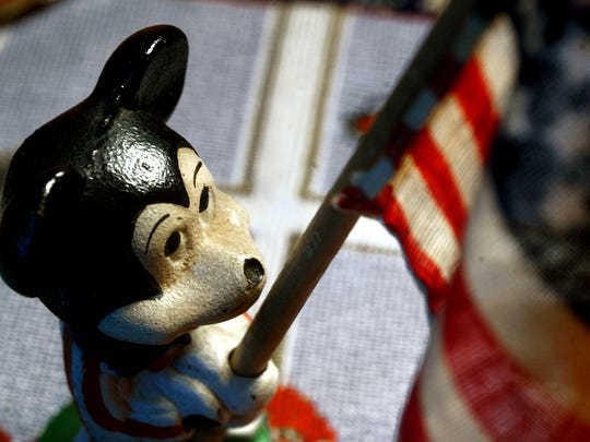 A vintage patriotic Mickey Mouse made of cast iron.