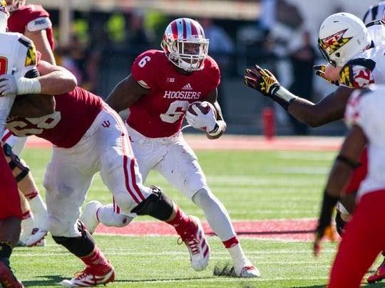 Indiana University junior Tevin Coleman (6) looks for a hole in the Maryland defense as he runs the ball past the line of scrimmage during second half action.
