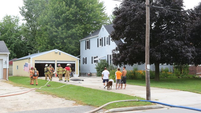 A fire on the second floor of a home in the Village of Cleveland displaced a family of eight and their two dogs.