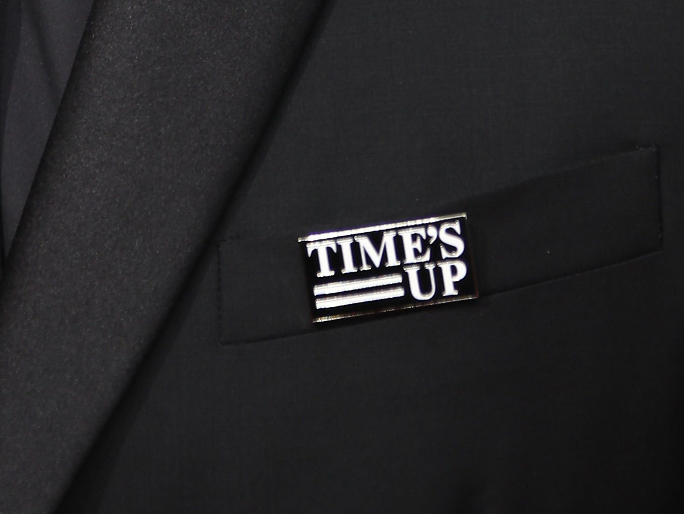Many men wore Time's Up pins to the Golden Globe Awards and other red carpet events to show their support for the protests against sexual misconduct.