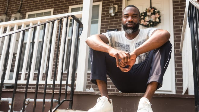 Writer and activist Darnell Moore sits outside of his sister's home in Camden earlier this summer.