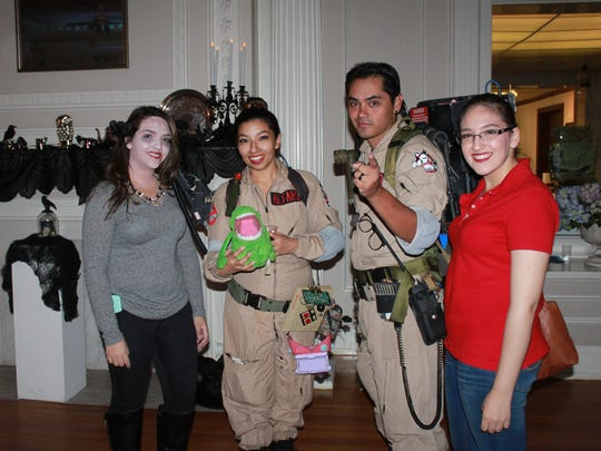 Fabiola Garcia, left, and Veronica Garcia with a couple of Ghostbusters.