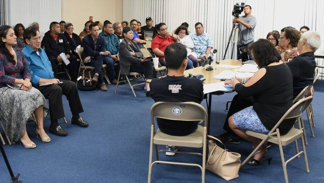 Roll call is conducted as island Democrats and others gather during a party meeting at the Guam Legislature on Tuesday, Sept. 13.