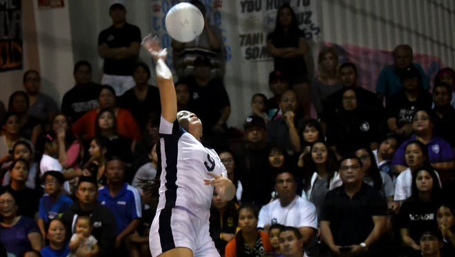 In this file photo, Joie Blas, of the Academy of Our Lady of Guam Cougars, skies for a kill shot against the Notre Dame Royals in an IIAAG Girls Volleyball League game at Academy on Oct. 4. The quarterfinals take place Friday at 6 p.m.