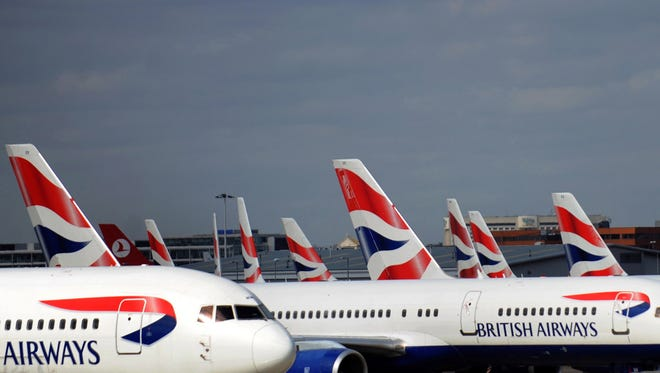A file photo shows British Airways aircrafts at Heathrow Airport in west London.