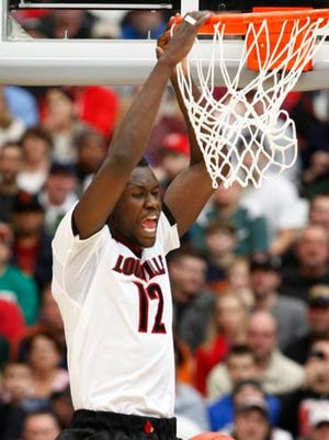 Mangok Mathiang scored 3 points in the first half Sunday, including on this dunk against Michigan State.