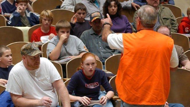 A Pennsylvania Game Commission hunting safety instructor addresses a group of students.