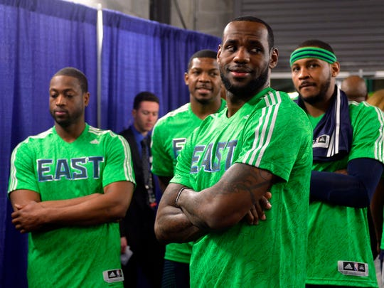 Feb 16, 2014; New Orleans, LA, USA; Eastern Conference forward LeBron James (6) of the Miami Heat, guard Dwyane Wade (3) of the Miami Heat, guard Joe Johnson (7) of the Brooklyn Nets and forward Carmelo Anthony (7) of the New York Knicks before the 2014 NBA All-Star Game at the Smoothie King Center. Mandatory Credit: Bob Donnan-USA TODAY Sports