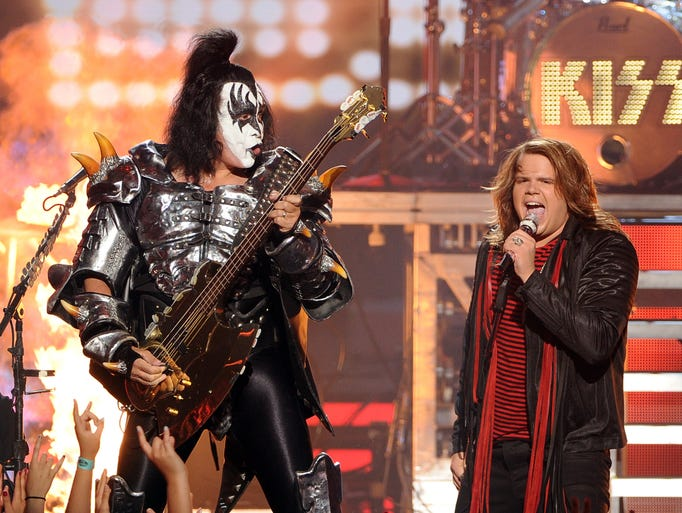 "LOS ANGELES, CA - MAY 21:  Musician Gene Simmons of KISS (L) and American Idol Finalist Caleb Johnson perform onstage during Fox's ""American Idol"" XIII Finale at Nokia Theatre L.A. Live on May 21, 2014 in Los Angeles, California.  (Photo by Kevin Winter/Getty Images)"