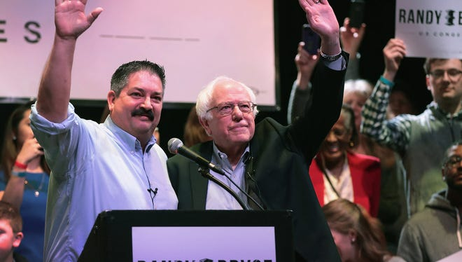 Randy Bryce (left) and Bernie Sanders, campaigning in Racine, Wis., in February 2018.