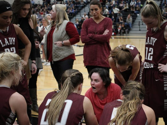 Station Camp coach Kendra Jackson draws up plays for