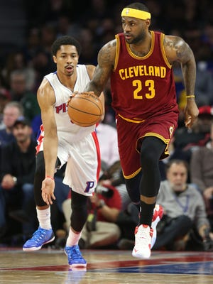 Pistons guard Spencer Dinwiddie defends against Cavaliers forward LeBron James during the second period of the Pistons' loss Tuesday at the Palace.