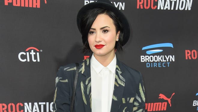 Demi Lovato arrives at the Roc Nation Pre-Grammy Brunch at RocNation Offices in Beverly Hills, California on Feb. 7, 2015.