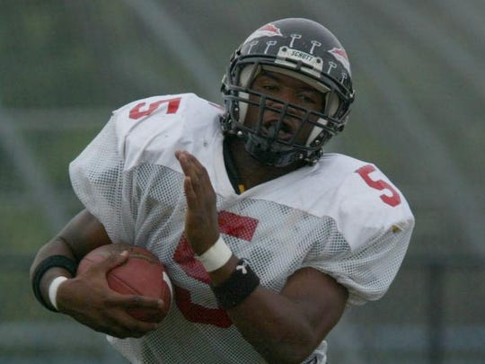 Keyport's Ken Cattouse breaks a long run against Asbury Park in a 2003 game.