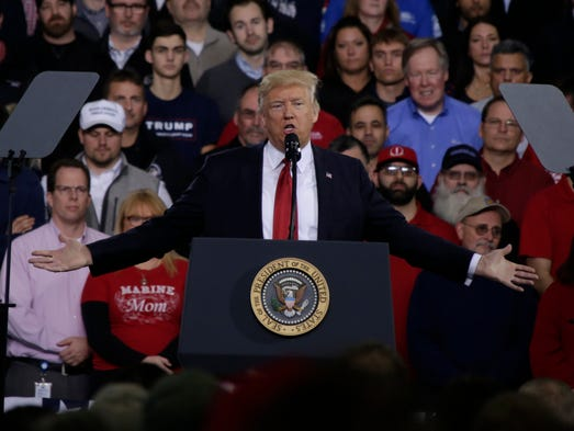 President Donald Trump speaks to a crowd at the American