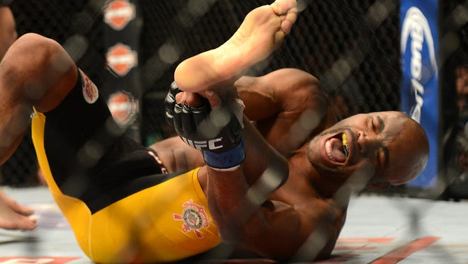 Anderson Silva reacts after breaking his leg on a kick to Chris Weidman during their UFC middleweight championship bout at the MGM Grand Garden Arena.