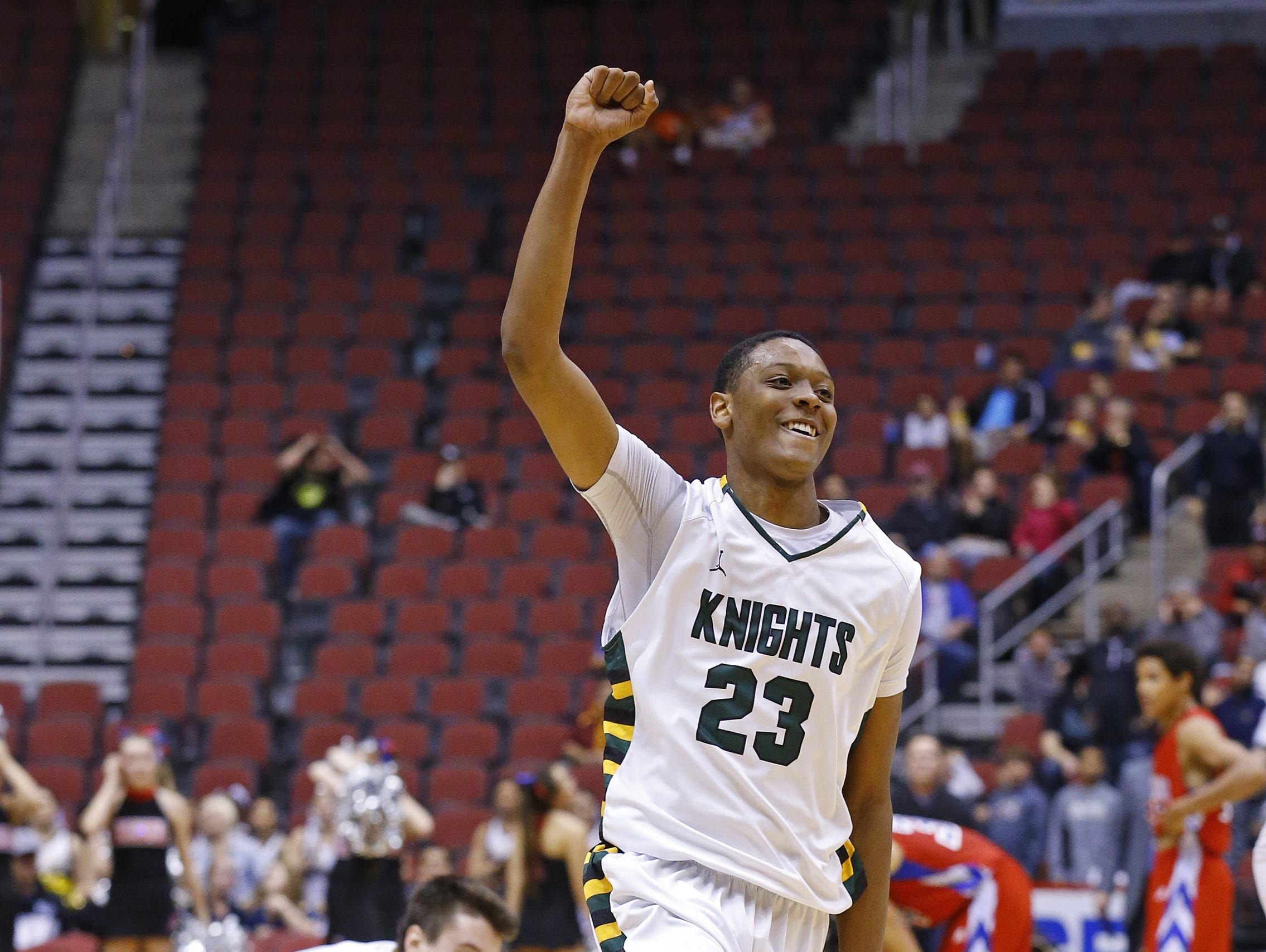 Gilbert Christian's Cameron Satterwhite (23) celebrates their win over Arcadia in their Division II boys basketball championship game Monday, March 2, 2015 in Glendale.