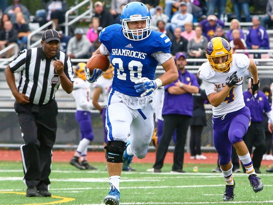 Catholic Central's Carson Kovath (with ball) makes