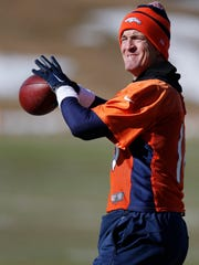 Peyton Manning passes the ball during practice Wednesday