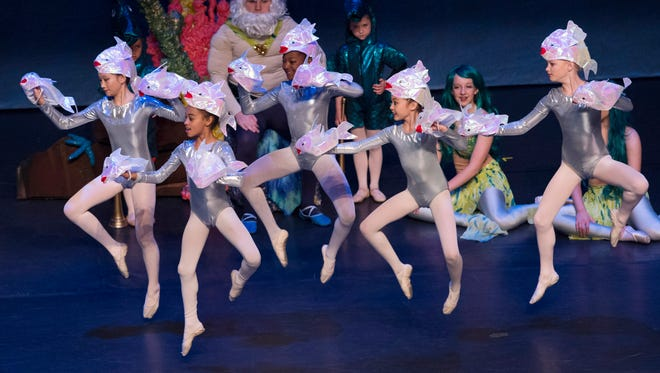 """A school of fish swims across the stage at the Preston Fine Arts Center during a performance of the Children's Center for Dance Education's """"The Littlest Mermaid"""" Friday morning. The dancers entertained hundreds of Henderson County first-graders."""