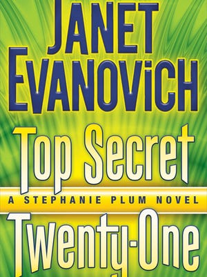 """This book cover image released by Bantam shows """"Top Secret Twenty-One,"""" by Janet Evanovich."""