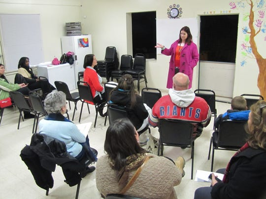 Finn Academy Head of School Maggie Thurber addresses a small crowd during an informational meeting in February at Hathorn Court apartments in Elmira.