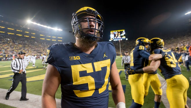 Patrick Kugler will help coach the offensive line as a graduate assistant at Michigan next season.