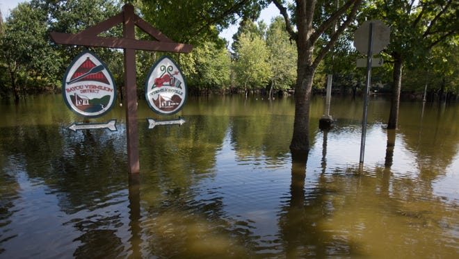 Floodwaters continued to fill the parking lot of Vermilionville August 25, 2016.